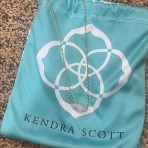 Kendra Scott necklace.